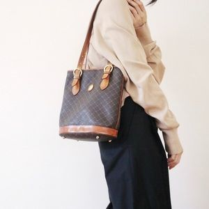 Brown leather print bucket bag